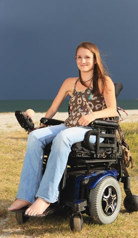 """The beach is completely accessible. The sand is packed, so I can wheel down pretty close to the water. It's beautiful."" — Katie Mathews"