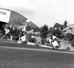 "Eric Walls, left, and Brad Parks side wheelie ""formation flying"" down a steep hill near the Quadra factory."