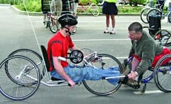 Ian Jaquiss (right), shown here teaching the fine points of hand-cycling, credits his good health to carefully monitoring his diet.