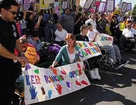 More than 300 disability advocates and former patients of Rancho Los Amigos Medical Center demonstrate in protest of the decision by the Los Angeles County Board of Supervisors to close the facility in 2003.