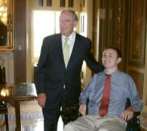 Josh Basile's journey has so far included launching two websites for people with SCI and working on legislation with disability champion Sen. Tom Harkin (left).