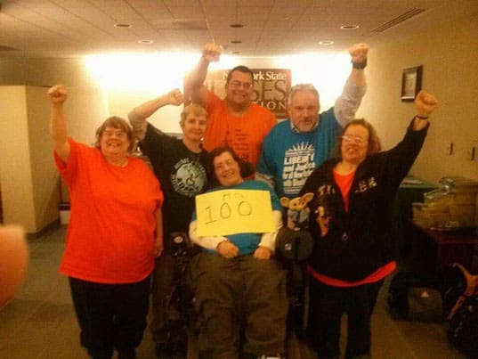 ADAPT activists celebrate the 100th hour of their sit-in.