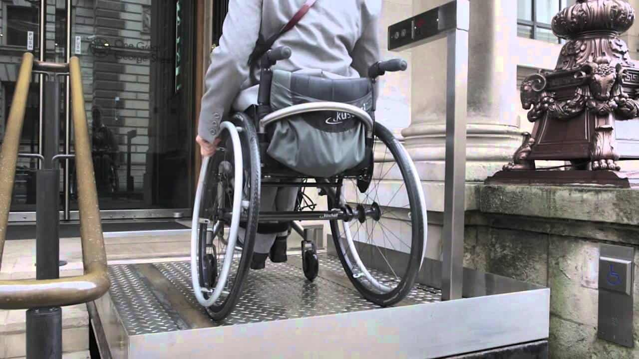 With the steps retracted, this wheelchair user rides the lift to the front door.