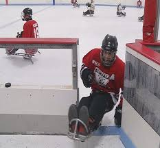 A sled hockey player takes a break from action on the ice at the retrofitted rink in Depew, NY.