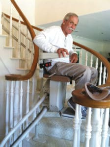 Mike Donohue on his Stannah 260 stair lift rounding the curve.